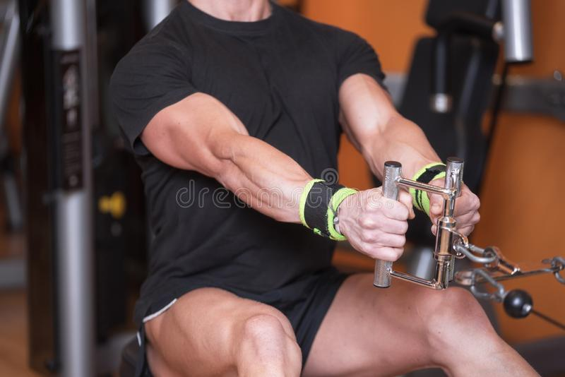 Close up Strong man training in gym dorsal top train. Close up Strong man training in gym dorsal top train stock photography