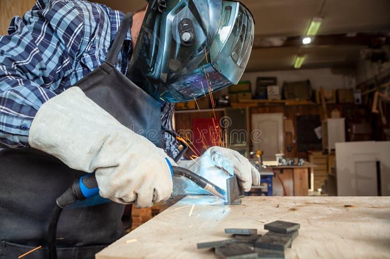 Close up of a strong man welder stock photos