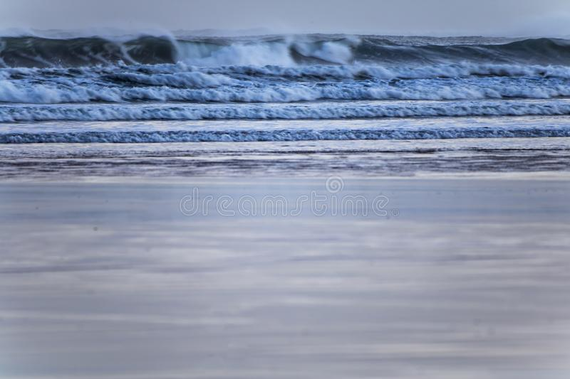Close up on strong powerful breaking waves on sandy beach of hendaye, france stock photo
