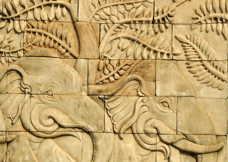 Download Close Up Stucco Carved Wall Depicting Elephants Stock Image - Image: 25796637