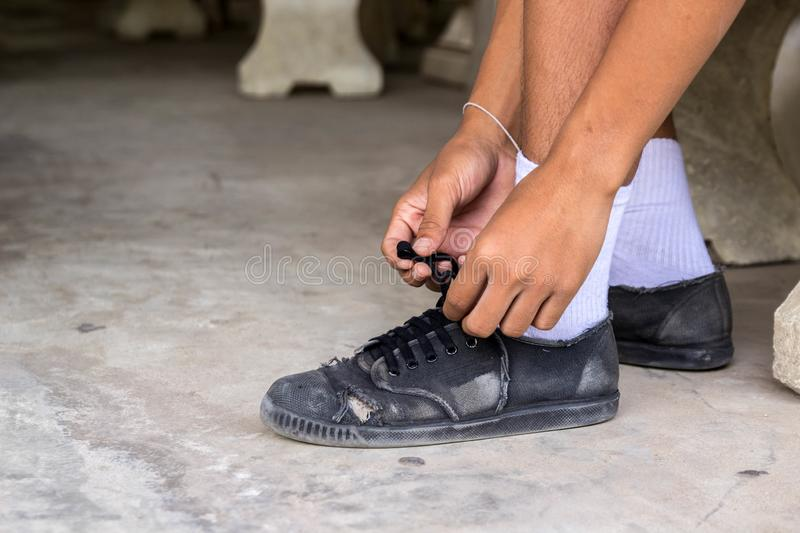 Close up of man leg and hands tying shoe laces royalty free stock photo