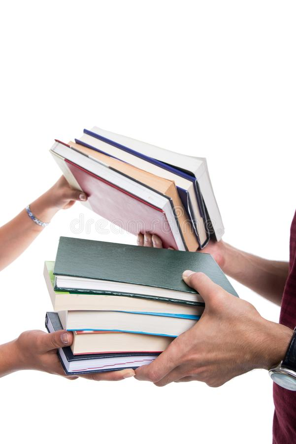 Close-up of students making books exchange stock image