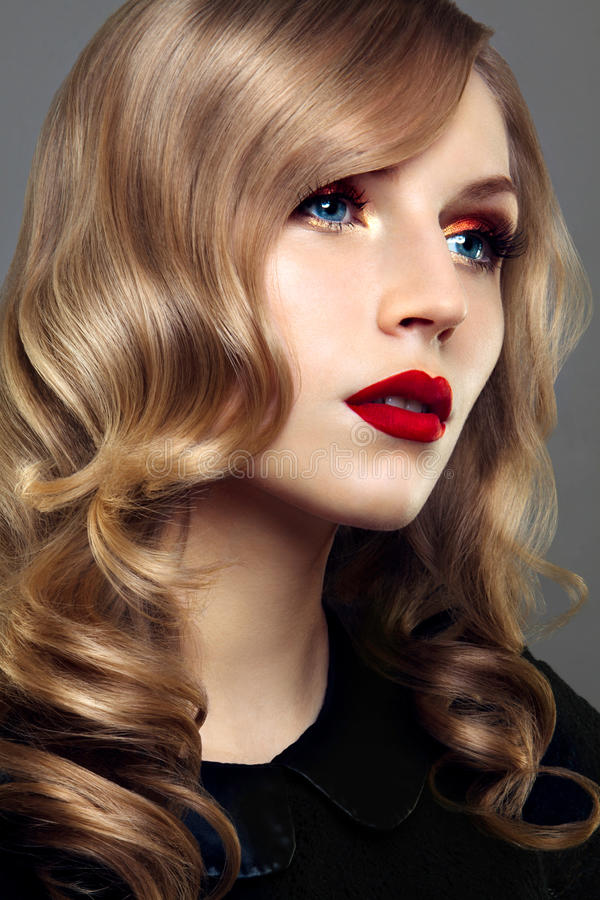 Close-up studio portrait of beautiful woman with bright make-up royalty free stock image