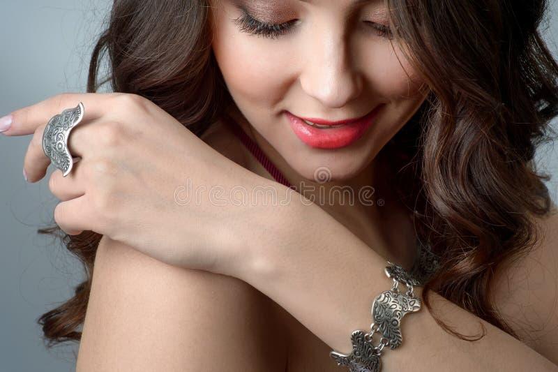Close-up studio portrait model demonstrate stylish ring and bra stock photo