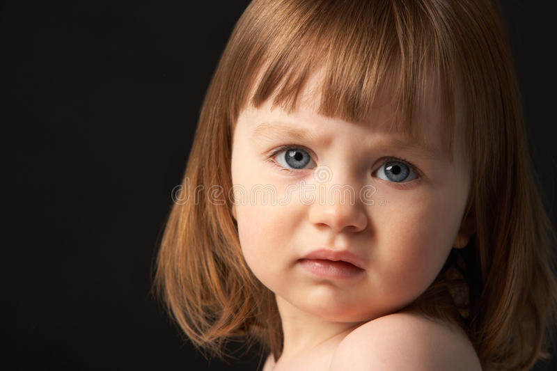 Close Up Studio Portrait Of Sad Young Girl royalty free stock images