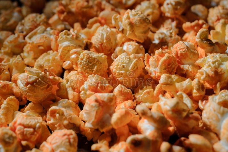 Close up shot of set of fresh warm salty popcorn with cheese stock image