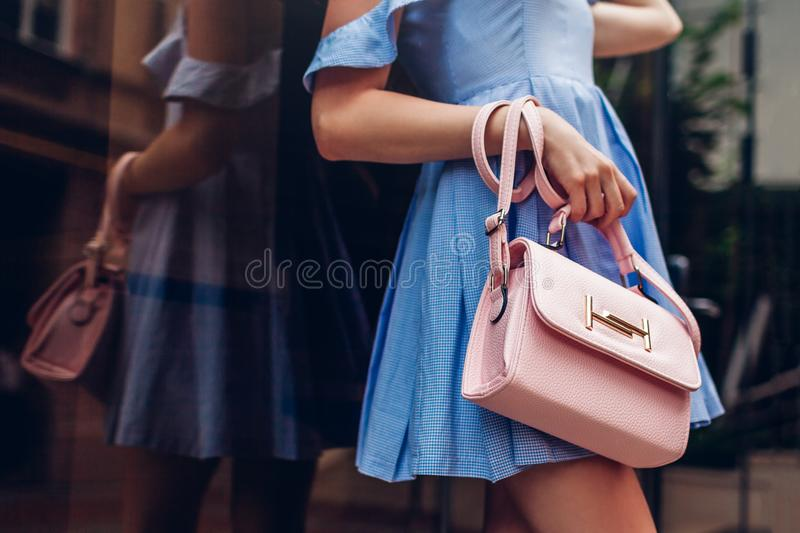 Close-up of stylish female handbag. Fashionable woman holding beautiful accessories outdoors. royalty free stock photos