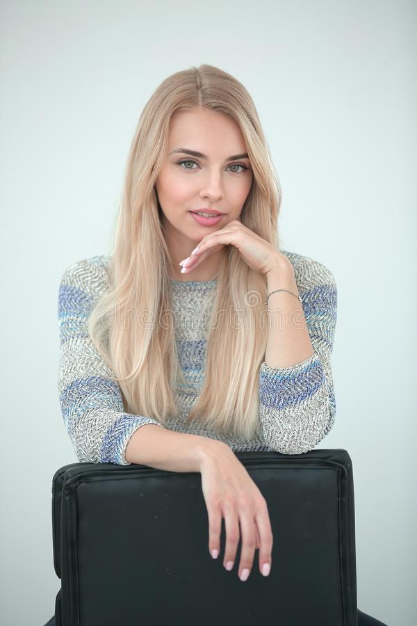Close up. stylish young business woman sitting on a chair stock photo