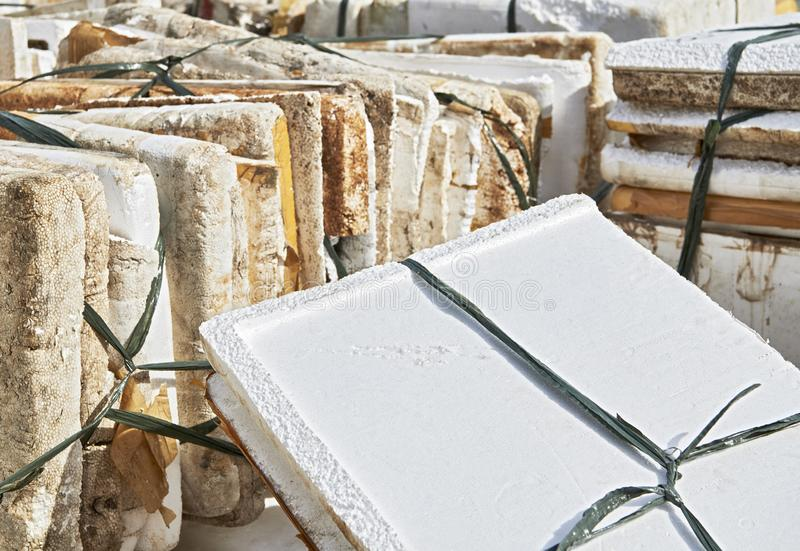 Close-up of styrofoam boxes cut into pieces and bundled stock images