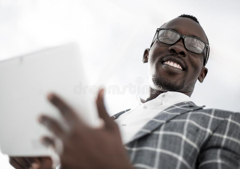 Close up.successful businessman on the background of the office royalty free stock photo