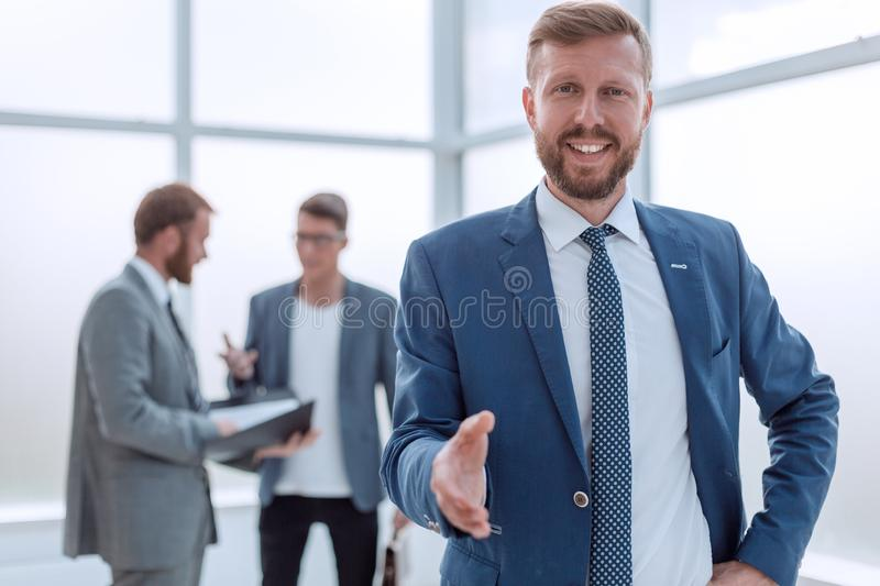 Close up.successful businessman meeting you in his office stock photography