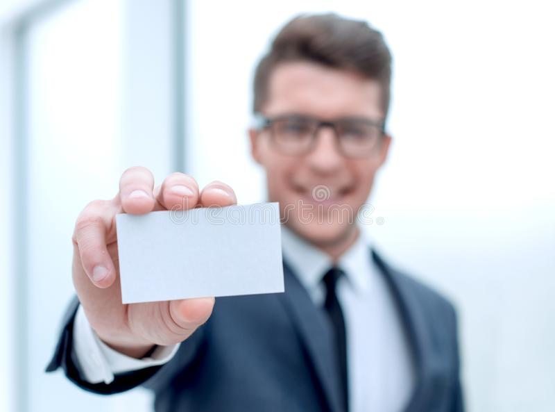 Close up.successful businessman showing his business card stock photography