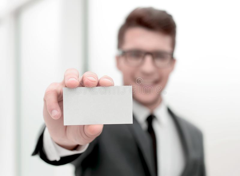 Close up.successful businessman showing his business card royalty free stock photos