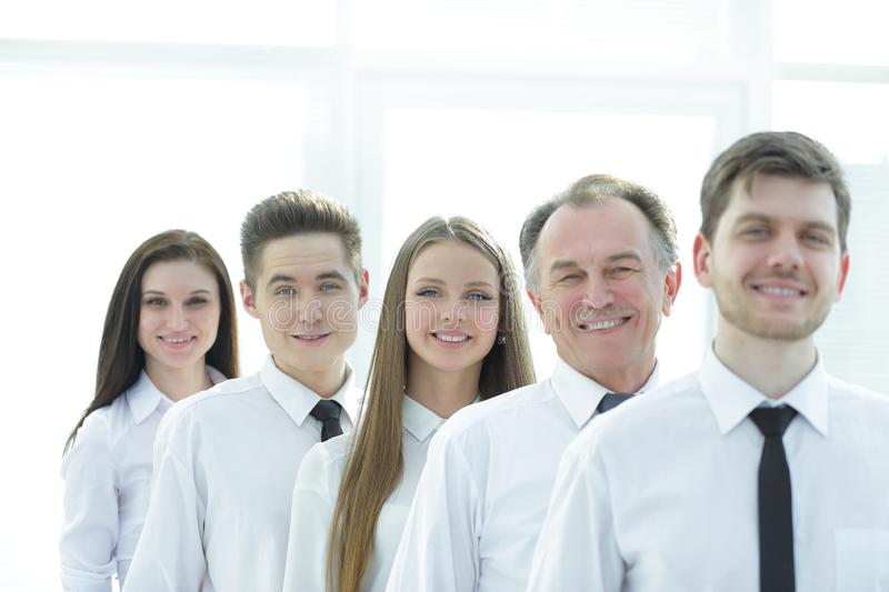 Close up. a successful group of employees standing in a row stock photo