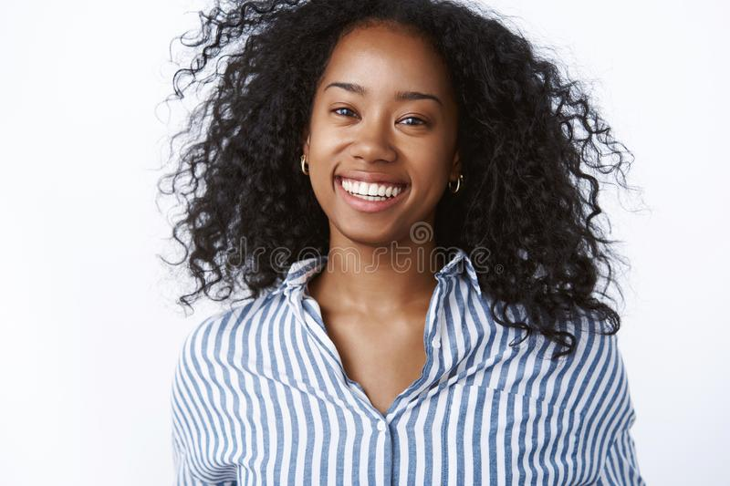 Close-up successful happy satisfied busiensswoman smiling broadly feeling carefree delight enjoying wellbeing, curly. Hair floating air grinning sincere, have stock photography