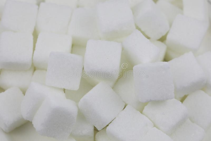 Many Sugar cubes. Close up of sugar cubes on white background with clipping path royalty free stock photos