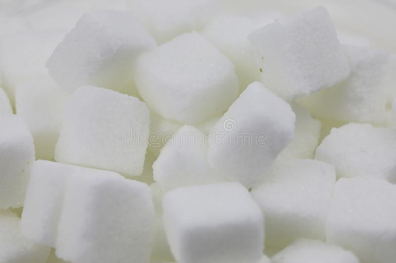 Many Sugar cubes. Close up of sugar cubes on white background with clipping path stock image
