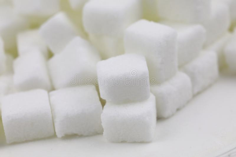 Many Sugar cubes. Close up of sugar cubes on white background with clipping path stock photos