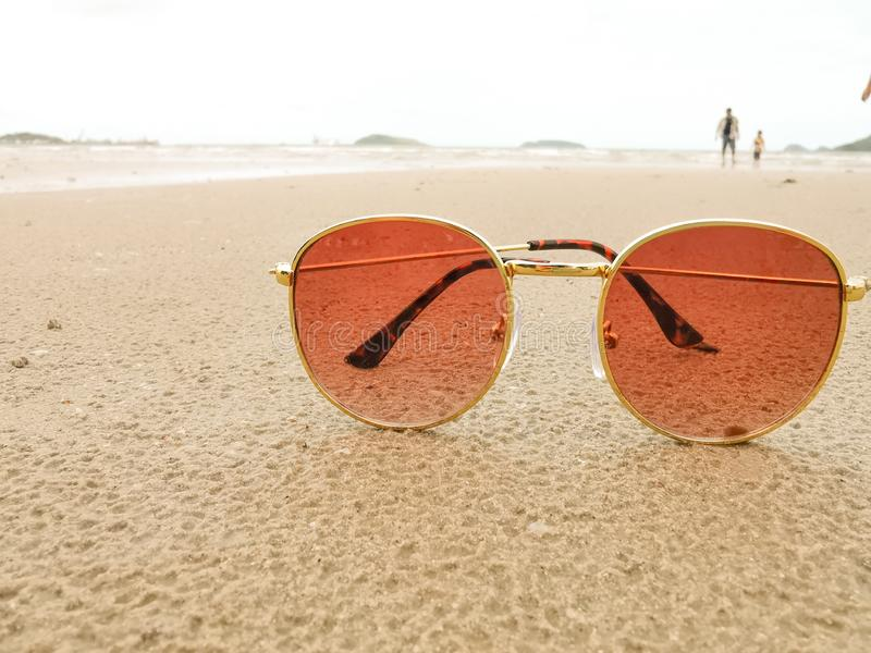 Close-up  sunglasses on the beach Suitable. For use as a decoration with copy space stock photography