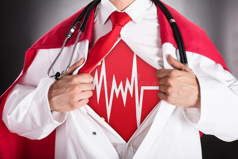 Superhero Doctor Showing Heartbeat Sign royalty free stock photos