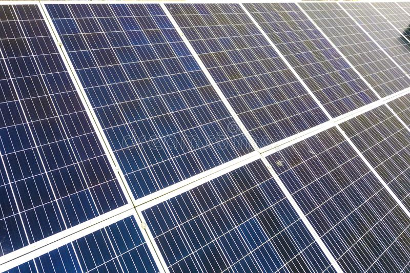 Close-up surface of blue shiny solar photo voltaic panels system on building roof. Renewable ecological green energy production. Concept royalty free stock photography
