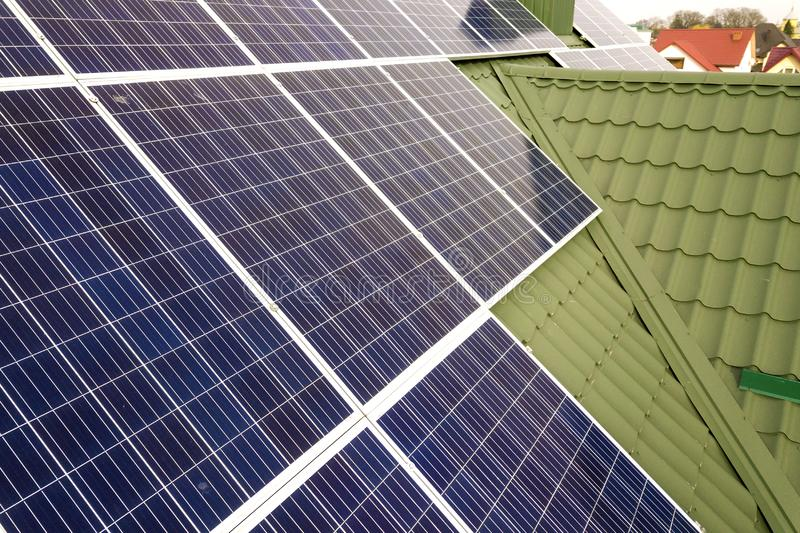 Close-up surface of blue shiny solar photo voltaic panels system on building roof. Renewable ecological green energy production. Concept royalty free stock photos