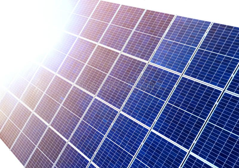 Close-up surface of lit by sun blue shiny solar photo voltaic panels. System producing renewable clean energy. Renewable. Ecological green energy production stock photo