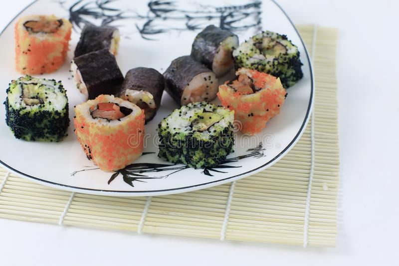 Close-up of sushi rolls on the plate stock photo