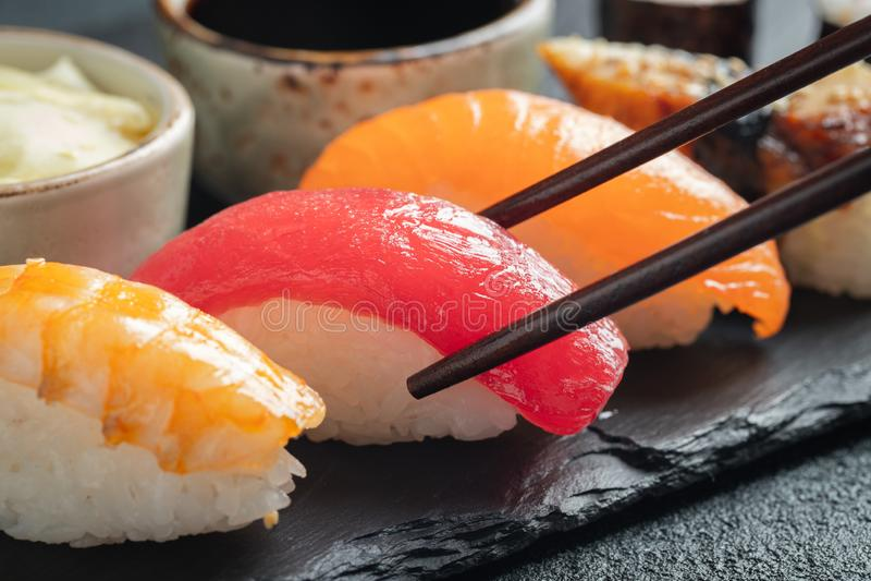 Sushi set of salmon, tuna and smoked eel royalty free stock photo