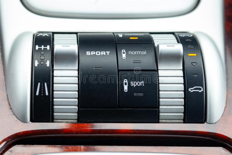 Close-up on the suspension control buttons for different road conditions with Sport level in car in the back of a suv after. Cleaning and detailing in the royalty free stock images