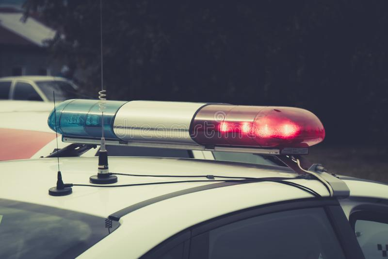 Close up of a swithched rotating beacon of a police car. The top of the police patrol car with flasher and antennas. A patrol car royalty free stock image