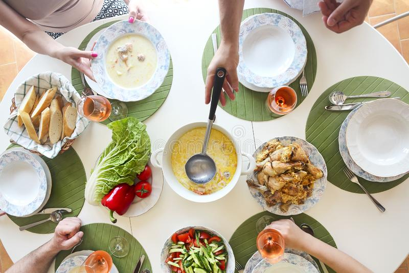 Close up of the table fish soup, salad and chicken. stock photography