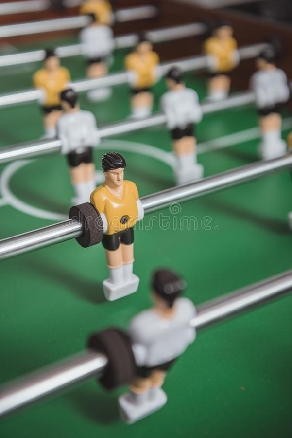 Close up of table soccer with football. Players silhouettes royalty free stock photo