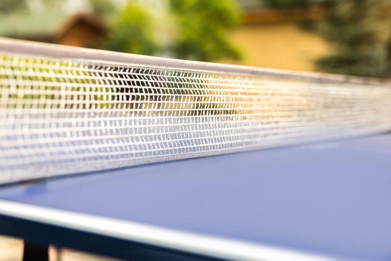Close-up table tennis net. Ping pong equipment outdoors. Family sport activity royalty free stock images