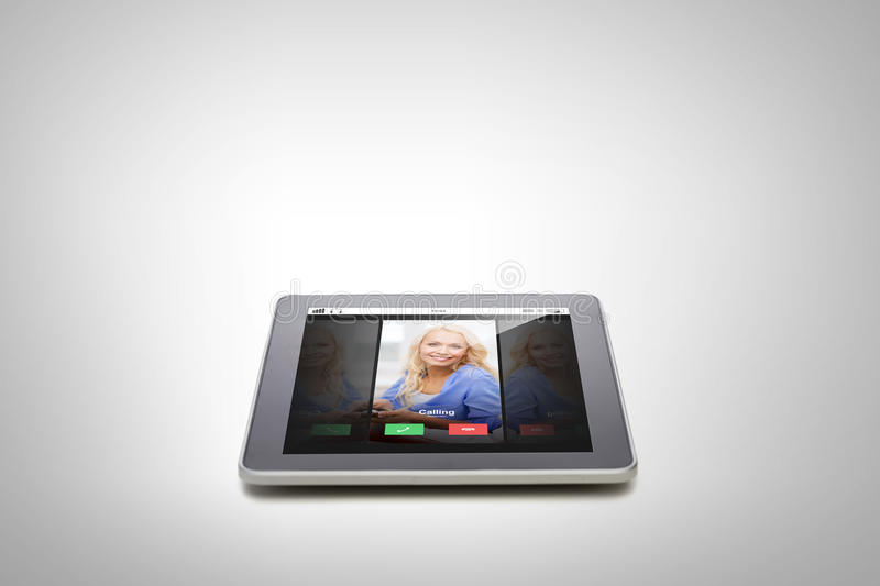 Close up of tablet pc computer with incoming call. Electronics, technology, advertisement and modern gadget concept - close up of tablet pc computer with stock photo