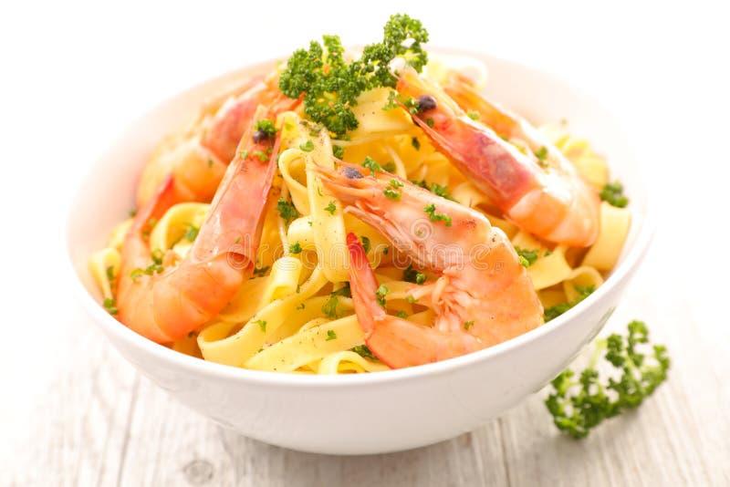 Taglatelle and shrimp stock photography