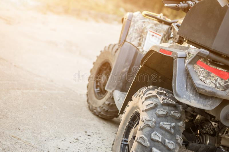 Close-up tail view of ATV quad bike. Dirty whell of AWD all-terrain vehicle. Travel and adventure concept.Copyspace.Toned royalty free stock images