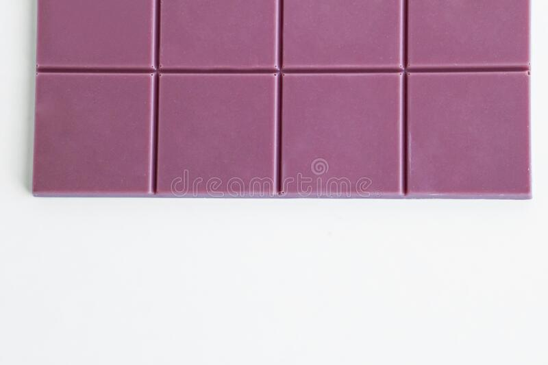 Natural Pink Color Ruby Chocolate Tablet on white background. Close-up taken of natural pink color Ruby chocolate tablet,space for text under stock images