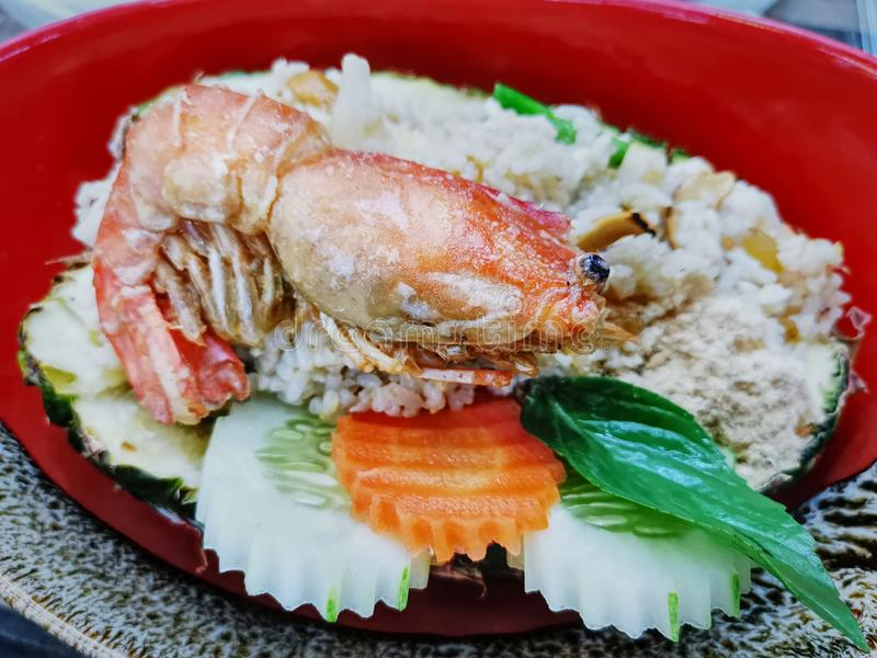 Close-up Tasty Pineapple Fried Rice with Crispy Prawn. High Angle View of Tasty Pineapple Fried Rice with Crispy Prawn royalty free stock photos