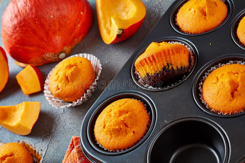 Close-up of tasty pumpkin chocolate muffins stock images