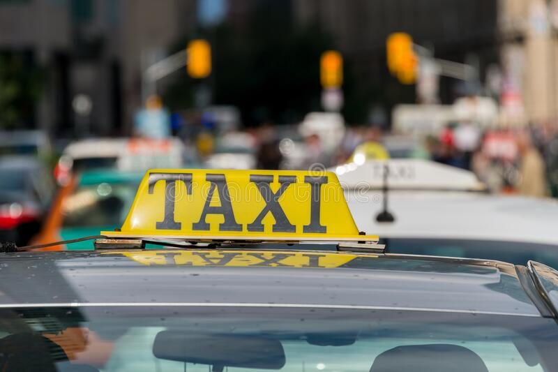 Taxi roof sign in Toronto, Canada. Close up of a taxi roof sign in Toronto, Canada stock photography