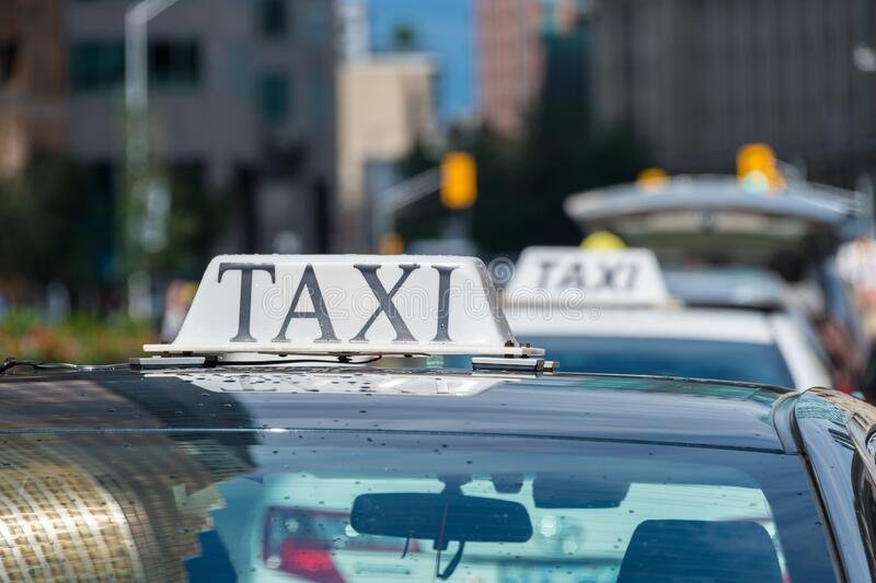 Taxi roof sign in Toronto, Canada. Close up of a taxi roof sign in Toronto, Canada royalty free stock images