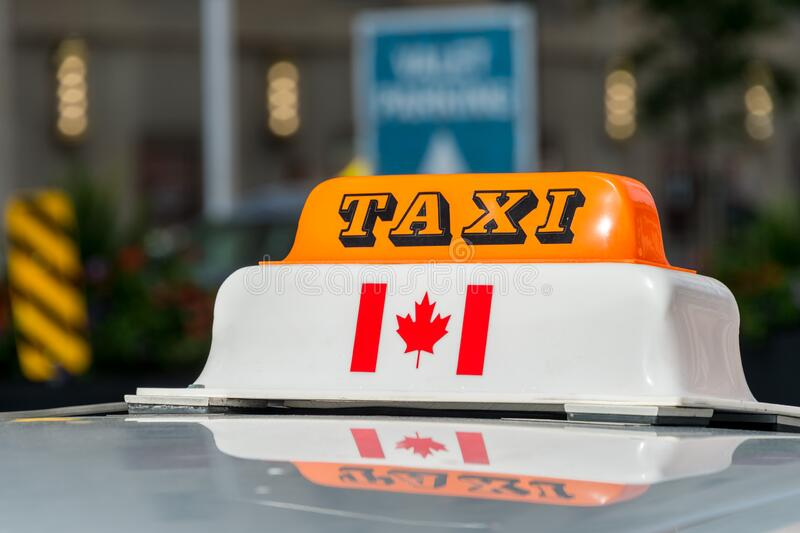 Taxi roof sign in Toronto, Canada. Close up of a taxi roof sign in Toronto, Canada stock photo