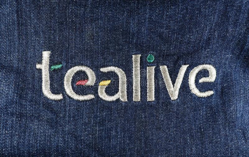 Tealive Embroidery Logo On Apron. Close-up of Tealive embroidery logo on a denim apron from Malaysia stock image