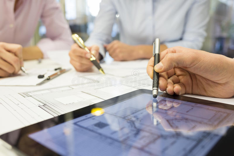 Close-up of Team architects working on construction project in o royalty free stock image