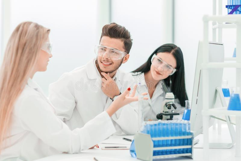 Team of scientists discussing something at the Desk royalty free stock photography
