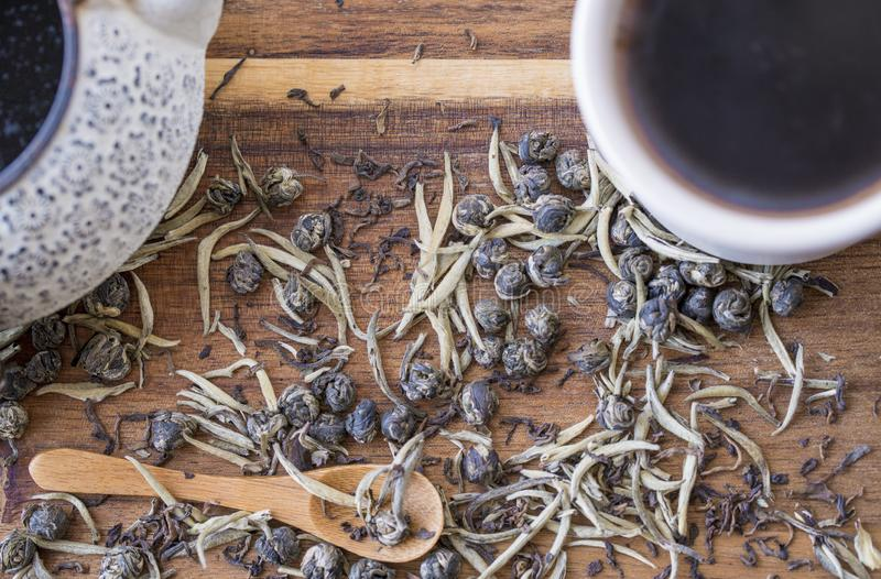 A close up of teapot, cup and tea leaves stock photos