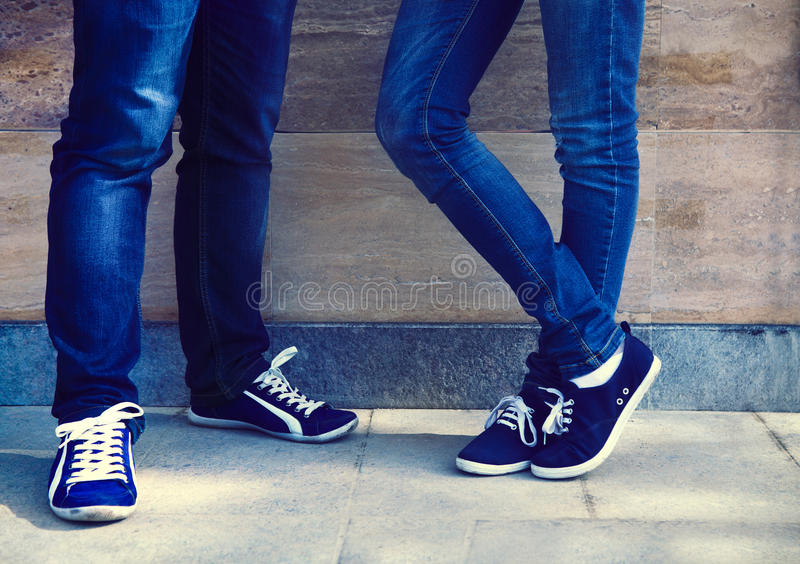 Close up of a teen couple wearing shoes stock photo