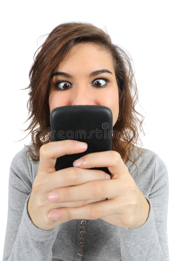 Close up of a teenager addicted to the smart phone. Isolated on a white background royalty free stock images