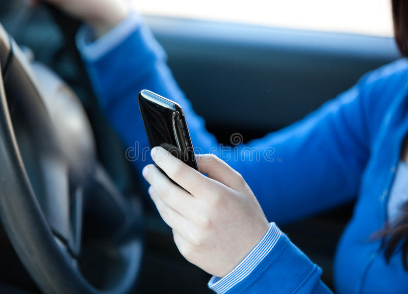 Download Close-up Of A Teenager Sending A Text In Her Car Royalty Free Stock Photo - Image: 15518955